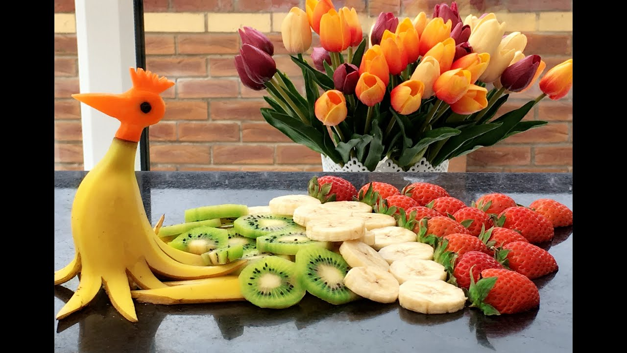 How to make banana peacock fruit carving garnish party - How to slice strawberries for decoration ...