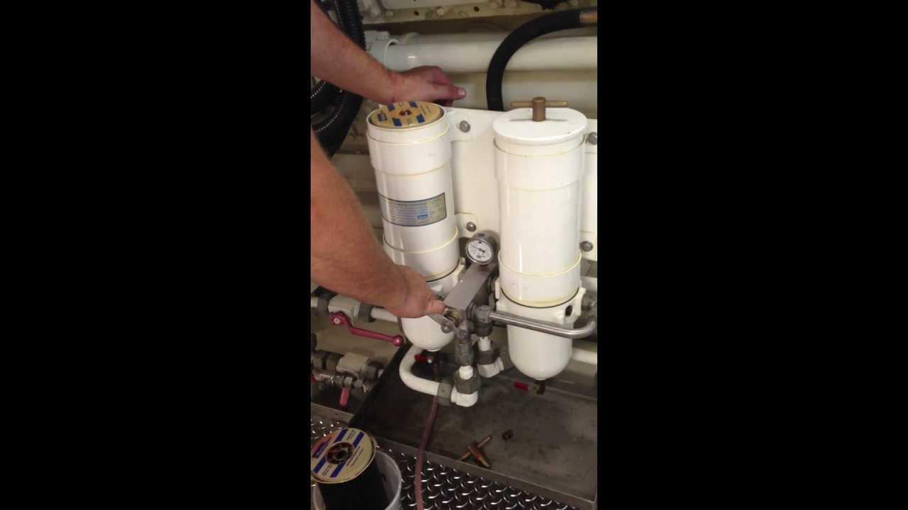 engineer schwack changes a racor fuel filter [ 1280 x 720 Pixel ]