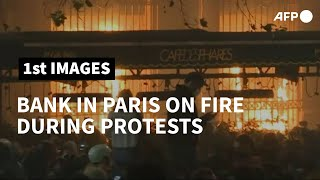 Bank on fire in Paris during protest over new security law | AFP