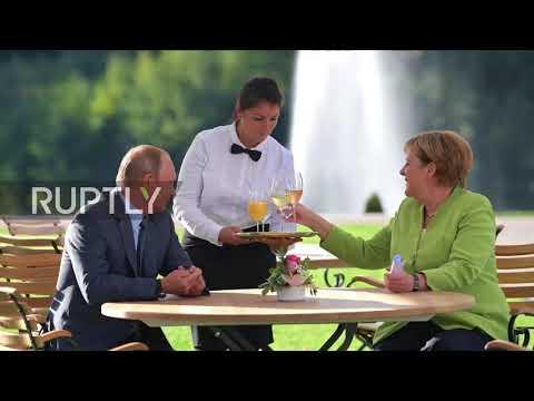 Germany: Prost! Putin And Merkel Enjoy A Tipple In The Sun *STILLS*