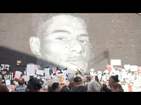 Britain: people gather in front of defaced mural in show of support to Marcus Rashford   AFP