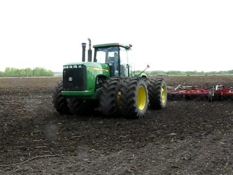 John Deere 9400 pulling 50 foot Field Cultivator.