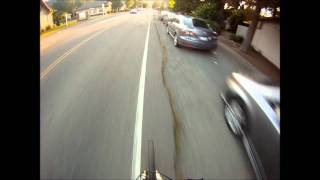 Mountain bike passing cars