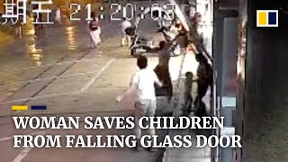 Woman saves children from falling glass door with her body in China