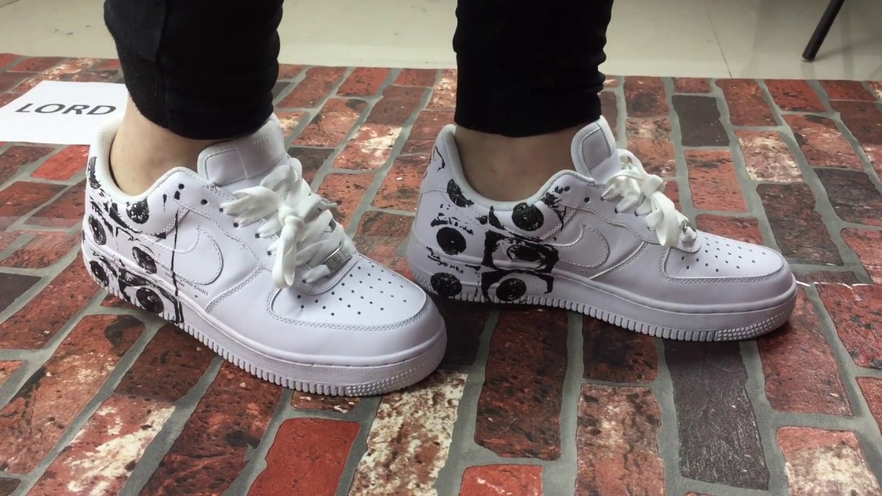 Supreme x CdG x Nike Air Force 1 Low Sneakers On Feet