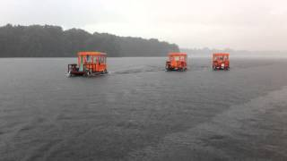 3 Flöße von 13kanus auf dem Seddinsee mit wenig Sonne