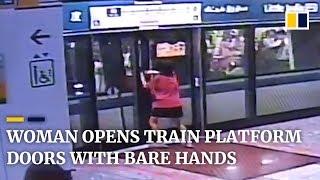 Woman opens train platform doors with bare hands