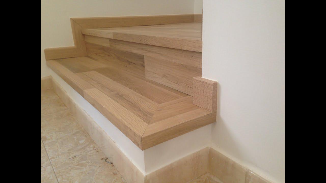 Revestimiento de escalera krono swiss noir blanc reformas for Materiales para escaleras de interior