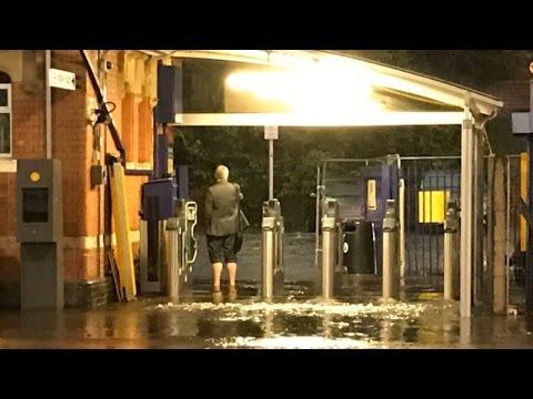 Passenger goes barefoot to exit flooded station