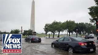Heavy rains trigger flash flooding in Washington, DC