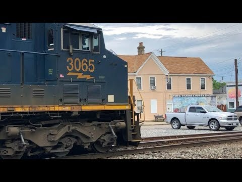 Heavy CSX Auto Racks Passing Model Train Hobby Shop Closing