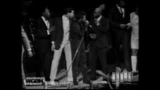 James Brown takes control as fans rush the stage. Live at the Boston Garden. April 5, 1968.