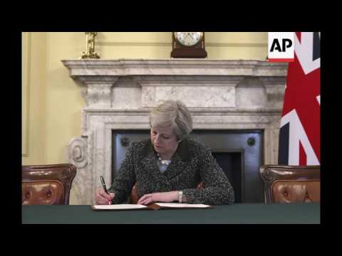 STILLS UK PM May signs order to trigger Article 50
