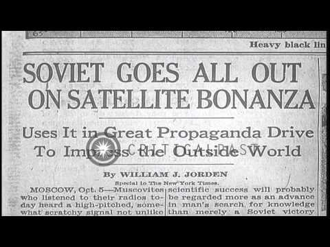 New York Times headlines about the Soviet going out on a satellite bonanza. HD Stock Footage