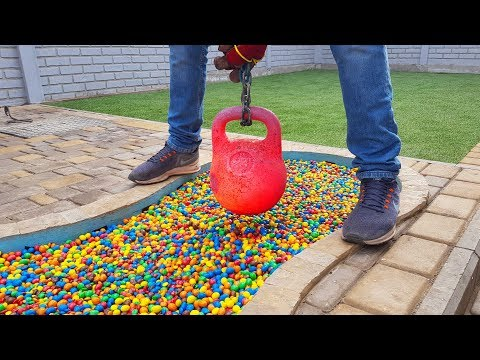 EXPERIMENT Glowing 1000 degree KETTLEBELL vs M&M's