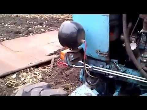 Регулировка давления в гидросистеме трактора.