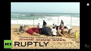 India: Syrian toddler Aylan Kurdi remembered with sand sculpture
