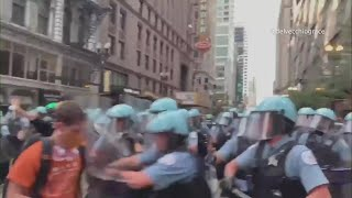 24 arrests after Chicago police, protesters clash Saturday night in the Loop