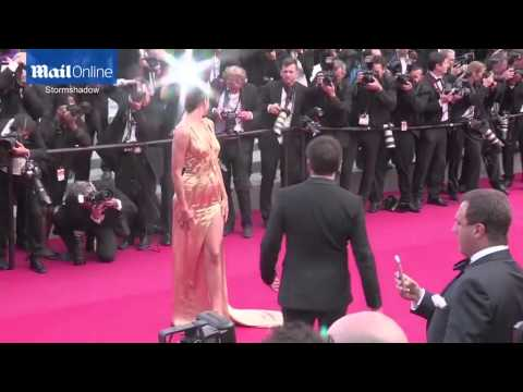 Irina Shayk glitters in gold metallic gown at Cannes premiere  Daily Mail Online