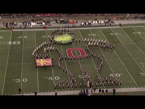 TBDBITL performs a holiday-themed halftime show