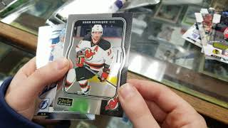 Opening hockey cards in Cow Over the Moon Sports Memorabilia store