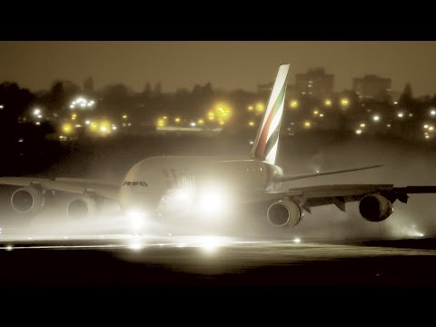 Emirates A380 - night arrival in heavy rain
