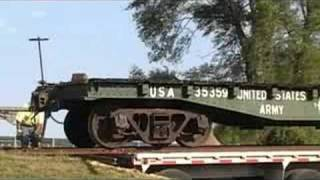 Former US Army Railroad Car is Unloaded From a Semi