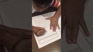 Umar writing his name