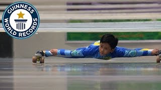 Farthest distance limbo skating under bars - Guinness World Records
