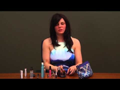Livia Scott puts on her makeup