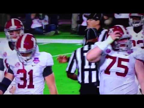 Barrett Jones pushes teammate AJ McCarron