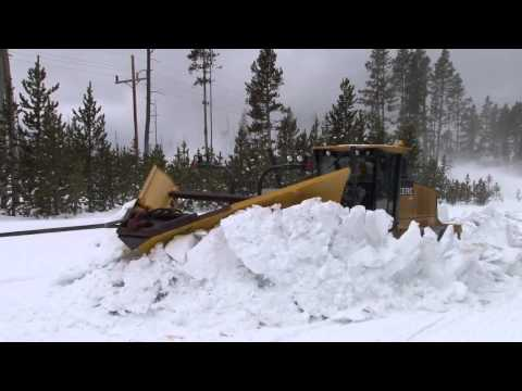 Plowing snow from roads in the spring in Yellowstone National Park