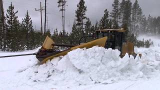 Plowing snow from roads in the spring in Yellowstone National Park thumbnail