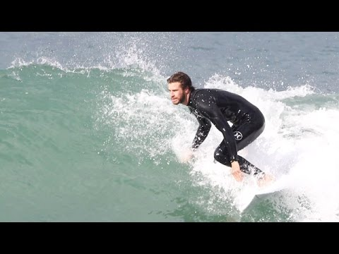Liam Hemsworth Riding The Waves In Malibu