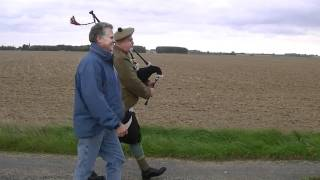 the Bagpipes while walking across a WW1 baefield