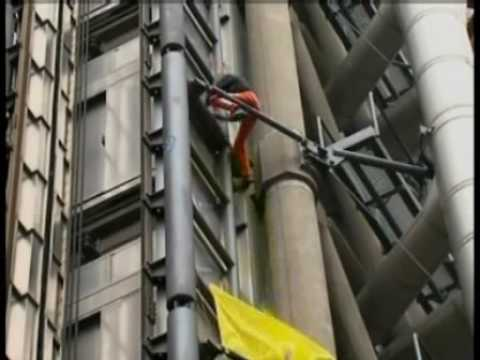 Alain Robert climbs the Lloyds Building in London G20 Protest