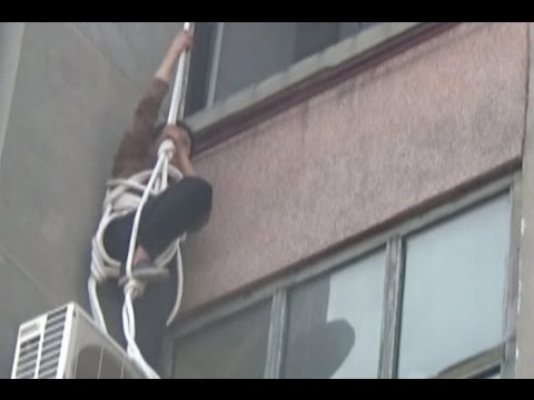 63-year-old Woman Attempts to Rappel into Locked Home