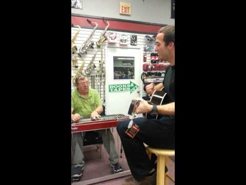 Patrick and music store man playing some Jimmy Buf