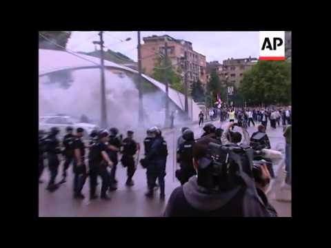 Ethnic Albanian and Serbian protesters clash in divided town
