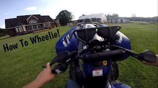 How to Wheelie a Automatic Four Wheeler!