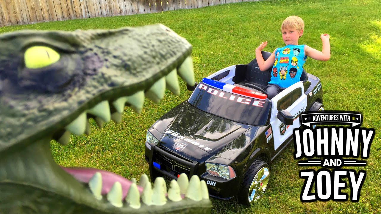 KID POLICE CAR By Kid Trax Chased By JURASSIC WORLD Puppet