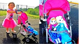 Girl Pushing Stroller with Elsa and Anna /Frozen Elsa and Anna Dolls /Niña Empujando Cochecito /