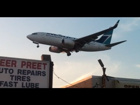Low flying Planes above highway at Toronto Pearson International Airport