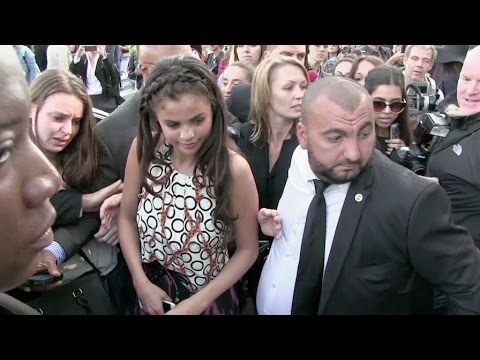 Teen idol Selena Gomez swarmed by fans at Louis Vuitton Fashion Show