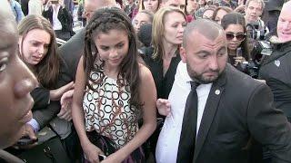 Teen idol Selena Gomez swarmed by fans at Louis Vuitton Fashion Show