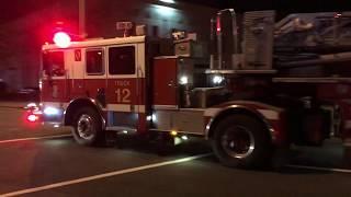 DCFD Truck 12 responding [2011 Seagrave tiller] to odor investigation