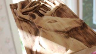 Carving a deer/ reindeer relief with Dremel.