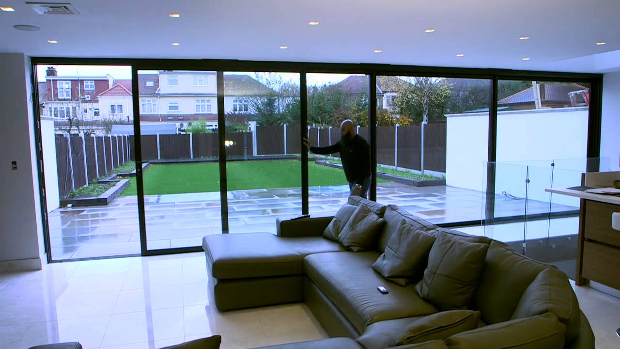 Enjoy the bright life with express sliding doors youtube for Oversized exterior doors for sale