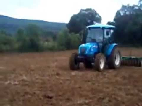 LS Tractor U60 c puxando grade 36 discos + rolo