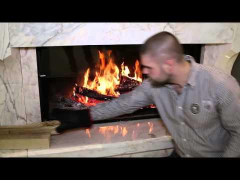 Отопление дома камином от Richard Le Droff. Мрамор Rose Aurore. Топка Empyrium 1200.